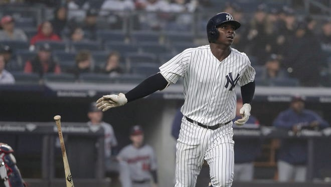 New York Yankees' Didi Gregorius watches his solo home run against the Minnesota Twins sail over the right field wall during the third inning of a baseball game, Wednesday, April 25, 2018, in New York.