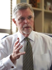 Oakland University President George Hynd talks about his plans for the university Aug. 21, 2014, at his office on campus in Rochester.