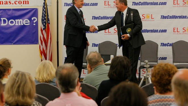 Yes, you're seeing right: Monterey County Sheriff Scott Miller and Deputy Steve Bernal shake hands before they come out fighting during the General Election Forum on Wednesday at the National Steinbeck Center in Salinas.