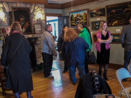 About 80 people attended the opening of Black Velvet: