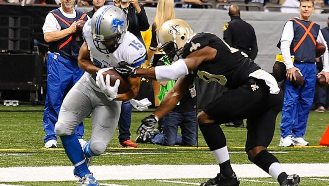Detroit Lions' Golden Tate makes a reception at the goal line for a touchdown in front of New Orleans Saints'  Delvin Breaux in the first quarter.