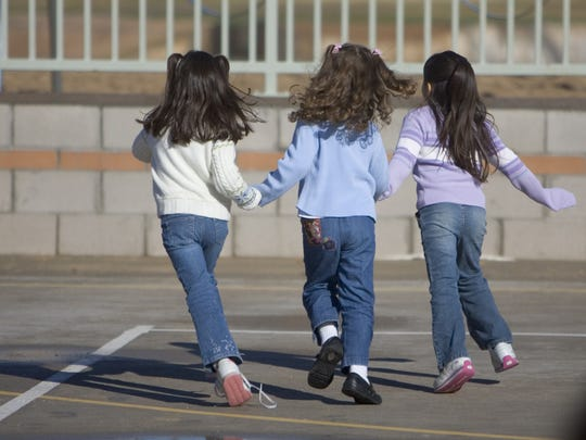 Members of the kindergarten class at Tavan Elementary in the Scottsdale Unified School District play outside.