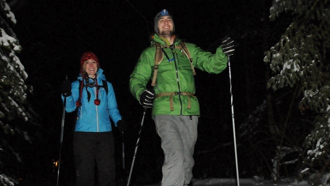 File photo of cross-skiers participating in a candlelight ski event in Door County.