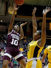 Mississippi State guard Jazzmun Holmes (10) shoots a jump shot past a Southern Mississippi player during the first half of an NCAA college basketball game in Hattiesburg, Miss., Friday, Dec. 14, 2018. (AP Photo/Rogelio V. Solis)