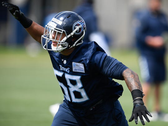 Titans outside linebacker Harold Landry (58) speeds