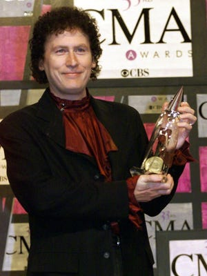 Randy Scruggs holds his award at the 1999 CMA Awards at the Grand Old Opry in Nashville. He was named the Country Music Association's Musician of the Year three times.
