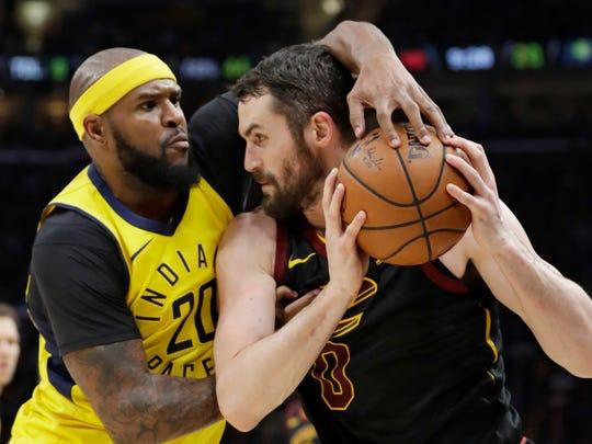 Indiana Pacers' Trevor Booker, left, puts pressure