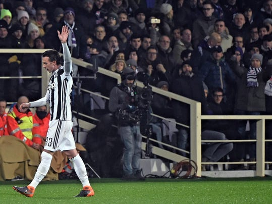 Juventus' Federico Bernardeschi, left, celebrates after scoring during a Serie A soccer match between Fiorentina and Juventus at the Artemio Franchi stadium in Florence, Italy, Friday, Feb. 9, 2018. (Maurizio Degl'Innocenti/ANSA via AP)