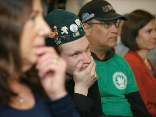 A crowd listens to speakers at a public hearing Tuesday,