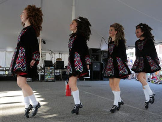 Dancers from the Rince na Chroi School of Irish Dance kick up their heels in 2013..