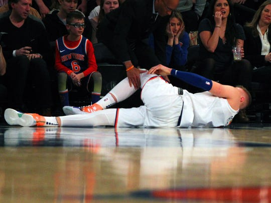 New York Knicks center Kristaps Porzingis (6) lays on the court after being injured against the Milwaukee Bucks during the first half at Madison Square Garden.