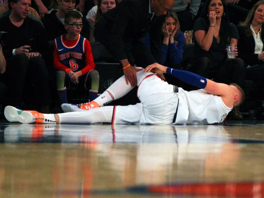 New York Knicks center Kristaps Porzingis (6) lays