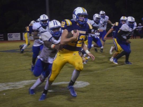 Buckeye High School's Drew Worthy (22, front) gets
