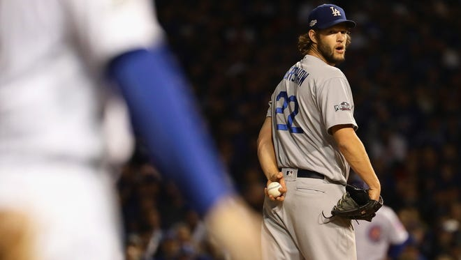 Clayton Kershaw #22 of the Los Angeles Dodgers looks at third base in the first inning against the Chicago Cubs during game six of the National League Championship Series at Wrigley Field on October 22, 2016 in Chicago, Illinois.