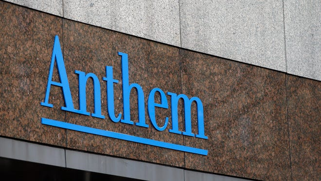 This Dec. 3, 2014, file photo, shows the Anthem logo at the company's corporate headquarters in Indianapolis. Anthem Inc., said Friday, Feb. 13, 2015, that it is offering several levels of free identity theft protection to current and former customers after hackers broke into a database storing information for about 80 million people.