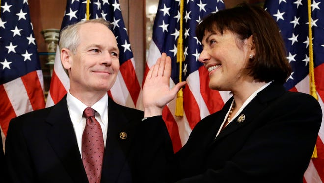 Kurt DelBene helps with a mock swearing in for his wife, Rep. Suzan DelBene, D-Wash., on Capitol Hill in 2012.