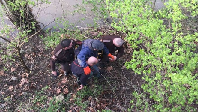 Hamilton County sheriff's deputies assist a man who got lost on Monday.