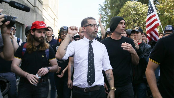 Right-wing provocateur and Vice Media co-founder Gavin McInnes pumps his fist during a rally at Martin Luther King Jr. Civic Center Park on April 27, 2017 in Berkeley, Calif. Protesters marched in opposition to the cancellation of a speech by American conservative political commentator Ann Coulter at the University of California-Berkeley.