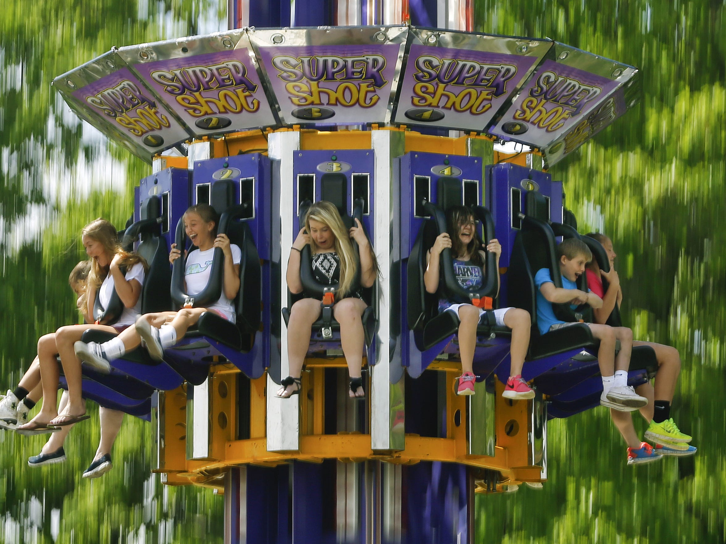 Thrill seekers find what they are looking for on the Super Shot ride during the Wilmington Flower Market in 2015 at Rockford Park.