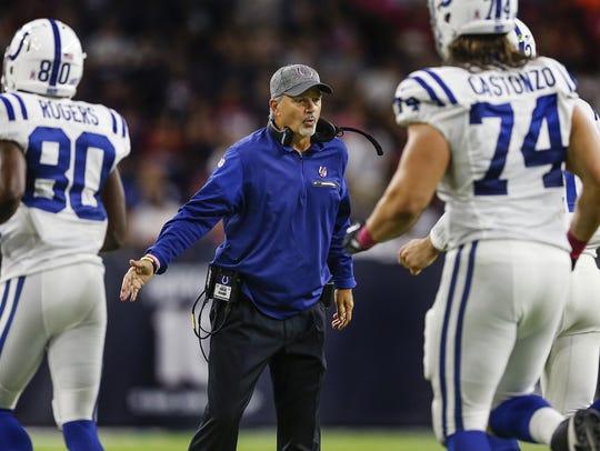 Indianapolis Colts head coach Chuck Pagano congratulates