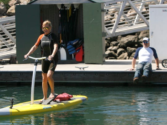 """Colleen Kelly, host of the PBS show """"Family Travel with Colleen Kelly,"""" rides a Hobie Mirage Eclipse in Channel Islands Harbor under the tutelage of Mike Lamm, owner of the Channel Islands Kayak Center. Kelly was filming an episode of her show in and around Oxnard."""