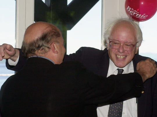 FILE: Rep. Bernie Sanders, I-Vt., right, reaches out