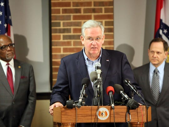 Missouri Gov. Jay Nixon, center, St. Louis County Executive Charlie Dooley and St. Louis Mayor Francis Slay call for peace as they discuss preparations in anticipation of the announcement of the grand jury decision in the Darren Wilson case, on Monday, Nov. 24, 2014, at the University of Missouri-St. Louis. A grand jury has reached a decision about whether to indict the Ferguson police officer in the shooting death of unarmed 18-year-old Michael Brown. (AP Photo/The St. Louis Post-Dispatch, Huy Mach) EDWARDSVILLE INTELLIGENCER OUT, THE ALTON TELEGRAPH OUT