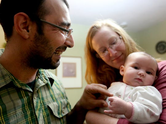 Ali Al Omrani, a Muslim refugee from Iraq and former interpreter with the United States Army, lives with his wife, Laura, and, 4-month-old daughter Myriam, in their West Salem home on Tuesday, Dec. 8, 2015.