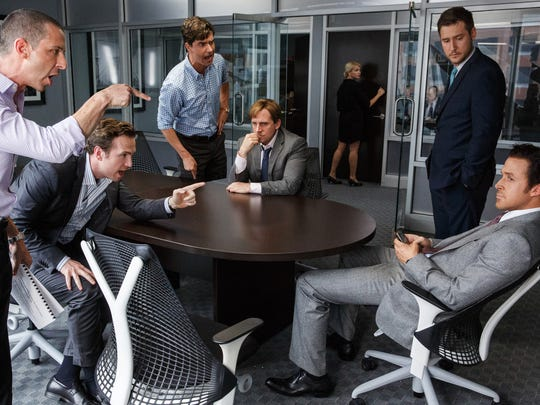 """From left: Jeremy Strong plays Vinnie Daniel, Rafe Spall plays Danny Moses, Hamish Linklater plays Porter Collins, Steve Carell plays Mark Baum, Jeffry Griffin plays Chris and Ryan Gosling plays Jared Vennett in """"The Big Short."""""""