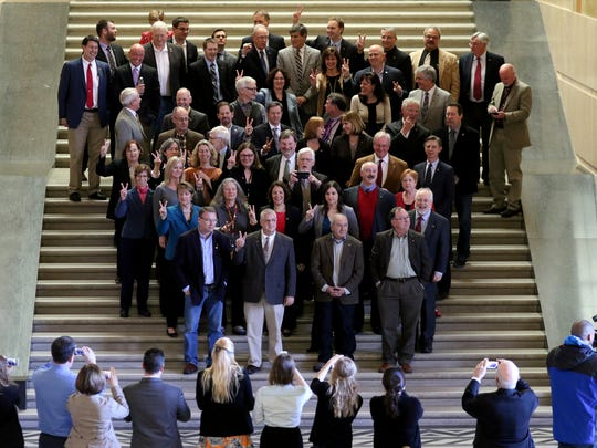 Members of the House of Representatives break session for a photo with Rep. Vic Gilliam before Sine Die to adjourn the 2016 legislative session at the Oregon State Capitol in Salem on Thursday, March 3, 2016.