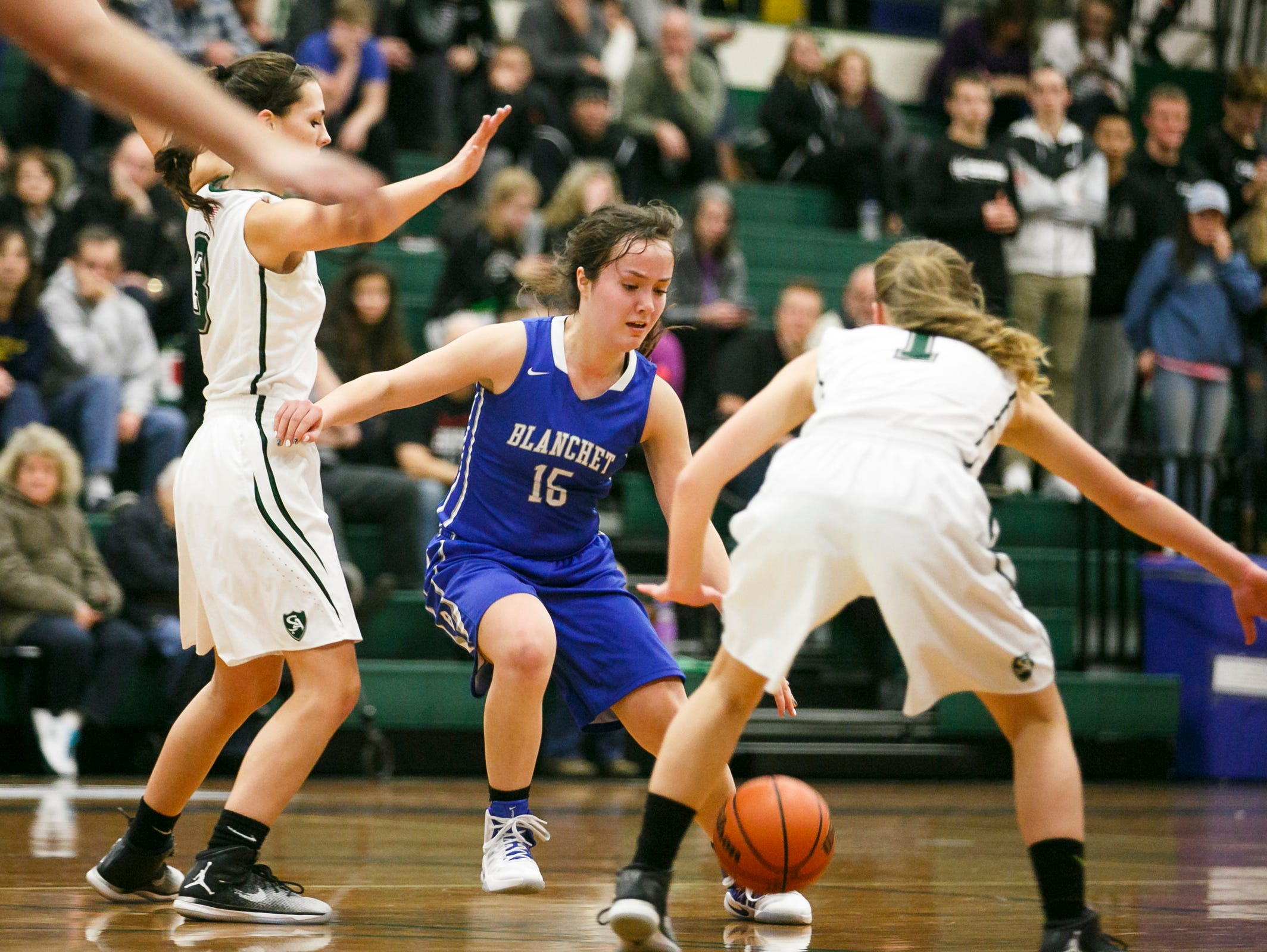 Blanchet's Sophia Poole (15) dribbles the ball around Salem Academy defense on Wednesday, Jan. 4, 2017 at Salem Academy. No. 4-ranked Blanchet defeated No. 1 Salem Academy 42-40 in the PacWest Conference game.