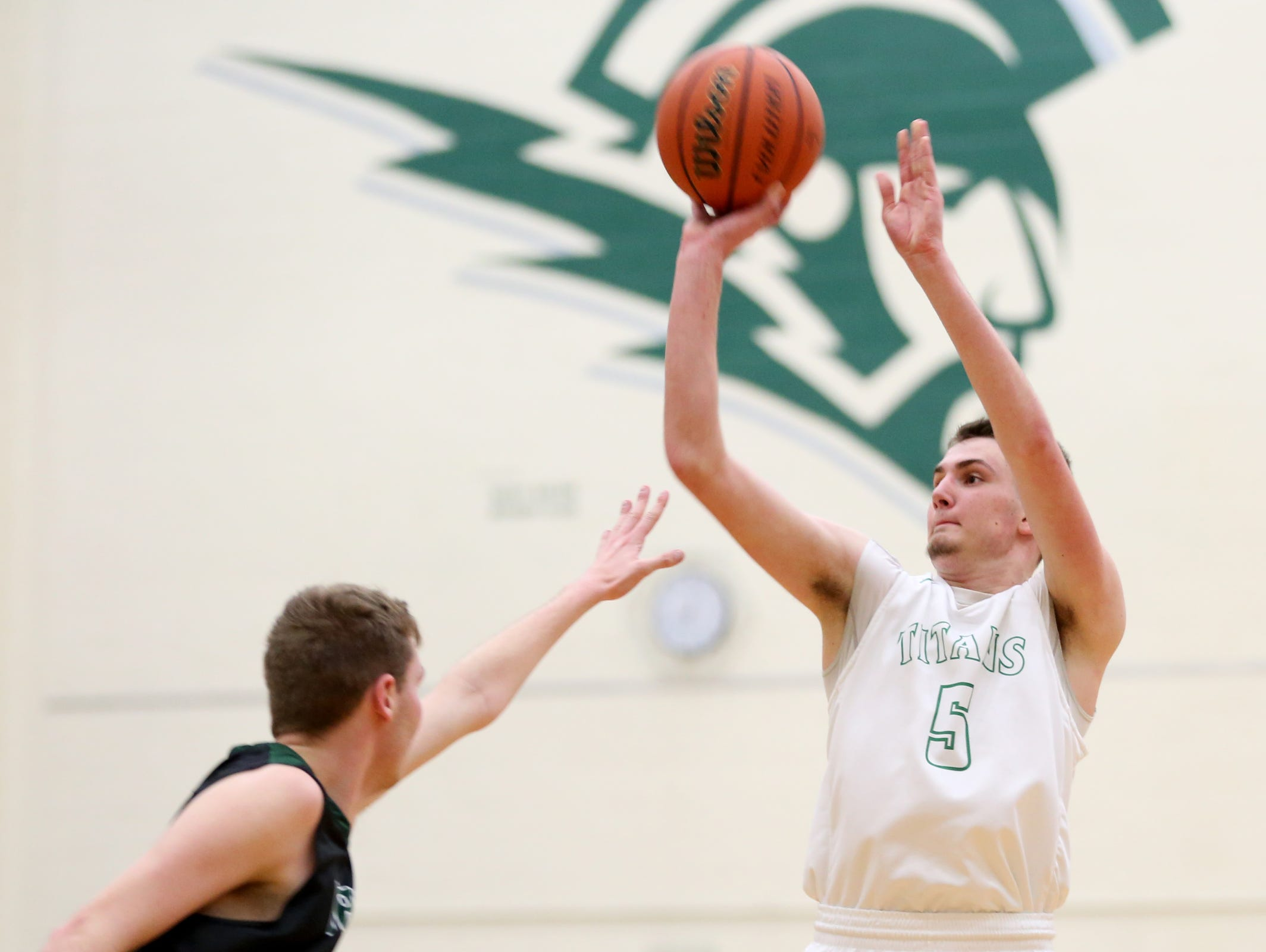 West Salem's Kyle Greeley (5) shoots for three points past Sheldon's Will Swank (33) in the second half of the Sheldon vs. West Salem boy's basketball game, in the first round of the OSAA State Championships playoffs, at West Salem High School on Wednesday, Feb. 28, 2017. West Salem won the game 71-59.