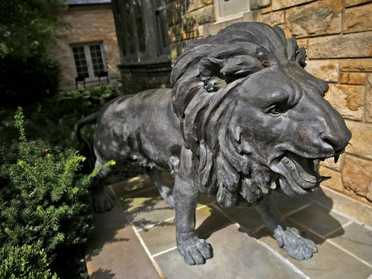 A wide variety of items for sale from 50 cents to $100,000 are being sold in the Carmel estate of technology guru Scott Jones, from Sept. 14 to Sept. 17.  Large lions at the front door, seen Thursday, Aug. 31, 2017, are for sale.  The sale is open to the public, first come first served.