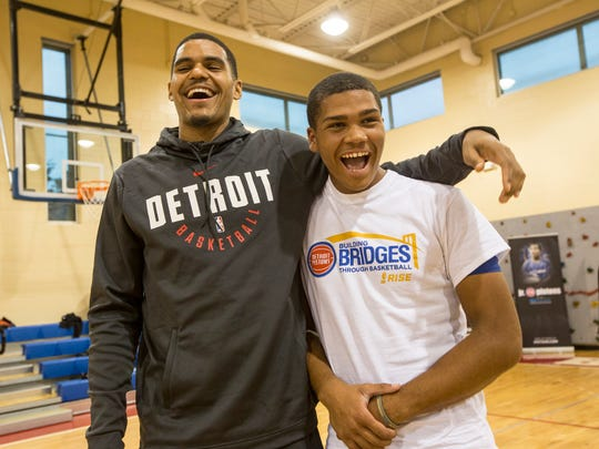 Detroit Pistons Tobias Harris jokes with Aaron Flowers, 18 of Detroit during the Building Bridges through Basketball program at  S.A.Y. Detroit Play Center in Detroit Mich., Wednesday, October 11, 2017.