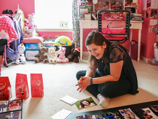 "Bella Simons, 17, laughs while preparing a poster board and candy bags for her ""Spa Night"" fundraiser that will raise money for Riley Hospital for Children at IU Health."