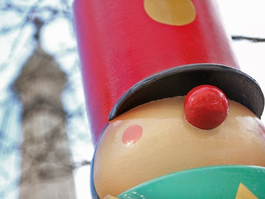 Toy soldiers and sailors and peppermint sticks statues, 52 in all, are being installed around the Monument Circle, Monday, November 17, 2014, as well as 20 artificial trees in basins and four lighted wreaths.  Work will be done on the Soldiers and Sailors Monument Monday and Tuesday, for this start to the festive holiday season.