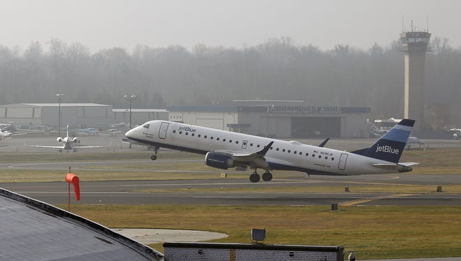 A JetBlue aircraft takes off at the Westchester County Airport in Purchase on Friday, Dec. 11, 2015.  The airport was closed for a brief period to clear a plane that overshot its landing on the runway.