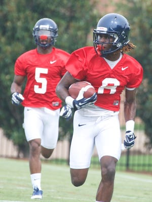 I'Tavius Mathers and Quincy Adeboyejo work a drill during practice in August 2013. Adeboyejo is Ole Miss' No. 1 slot receiver this season.