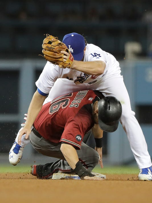 Arizona Diamondbacks' Chris Owings, bottom, is caught stealing second base by Los Angeles Dodgers' Charlie Culberson during the fifth inning of a baseball game, Wednesday, Sept. 7, 2016, in Los Angeles. (AP Photo/Jae C. Hong)