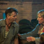 """Owen Wilson, right, and Lake Bell appear in a scene from """"No Escape."""""""