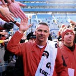 Ohio State head coach Urban Meyer pumps up his team to play Hawaii last Saturday in Columbus.
