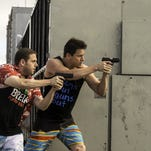 """Channing Tatum, left, and Jonah Hill are shown in a scene from """"22 Jump Street,"""" new in area theaters this weekend."""