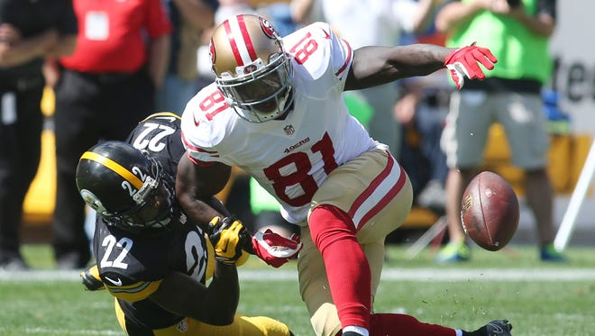 Sept. 20, 2015; Pittsburgh; Pittsburgh Steelers cornerback William Gay (22) strips the ball from San Francisco 49ers wide receiver Anquan Boldin (81) during the first quarter at Heinz Field. The pass was ruled incomplete.