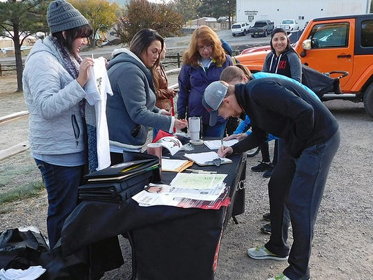 Runners register for the Zombie Run Saturday.