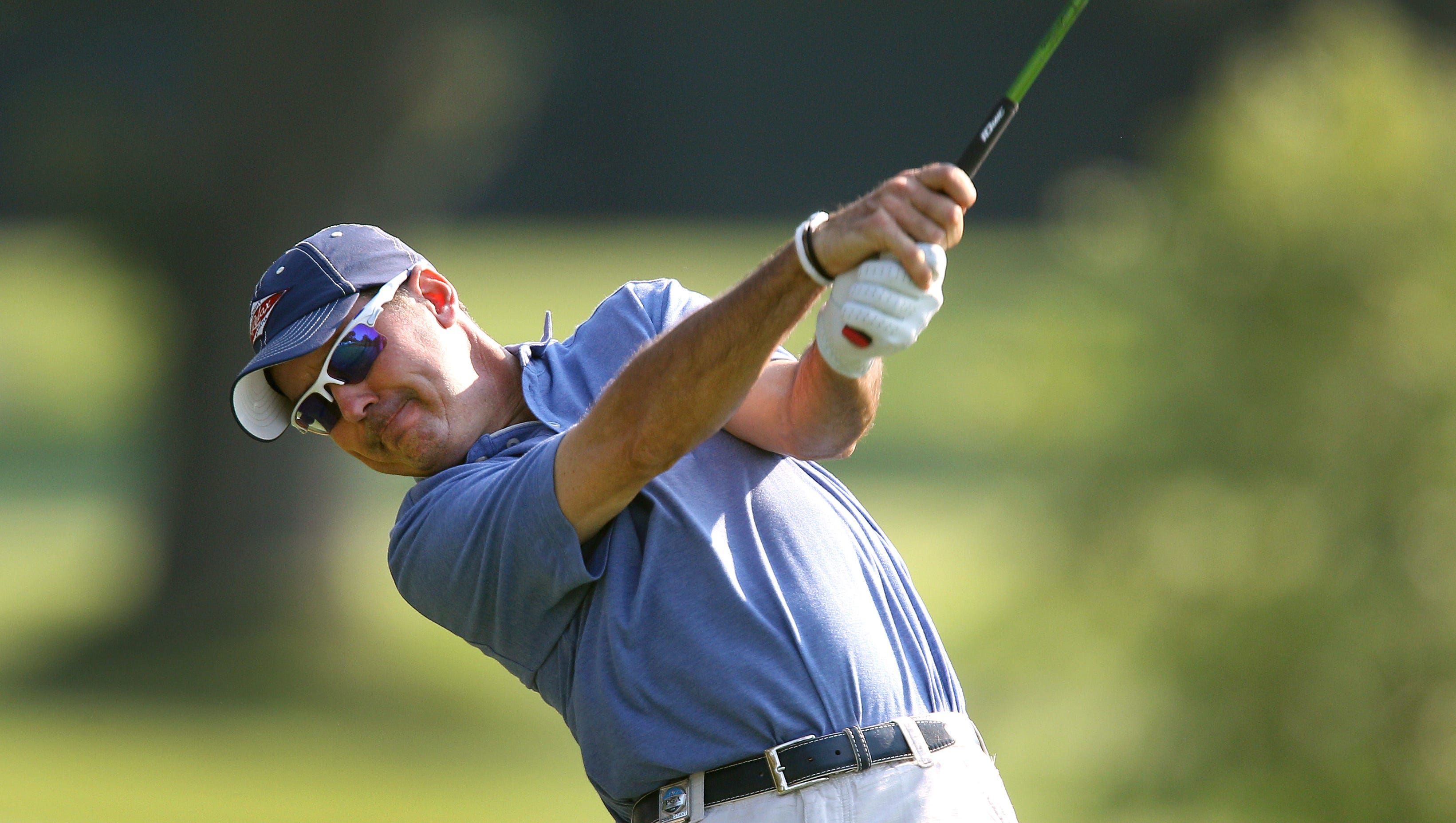 Former PGA champion Rich Beem drives off the 9th tee.