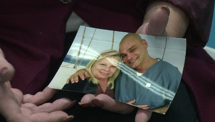 Mark Berrios' mother, Margaret Loring, shows a picture