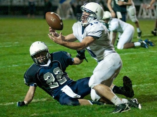 West York's Jerrin Toomey nearly grabs an INT Friday, while Dallastown's David Butler watches.
