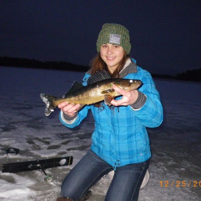 "Beth Sommerfeldt with a 17"" inchwalleye caught & released from a Price County water."