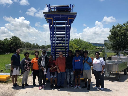 Teenage members of Boys & Girls Clubs of St. Lucie County recently visit with Phoenix Metals owner Bill Wilcox on a recent tour of his business in Fort Pierce.