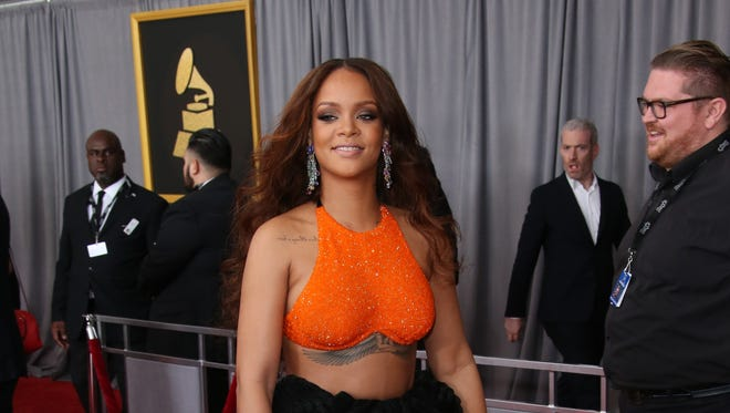 Rihanna arrives at the 59th Annual Grammy Awards